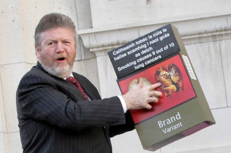 James Reilly with a (larger) example of what a plain pack will look like.