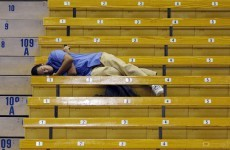 If you're going to fall asleep on the job, try not let it happen on a basketball court