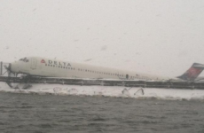 24 people injured as Delta plane skids off runway in snow storm