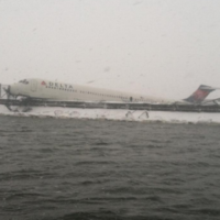 24 people injured as Delta plane skids off runway in snow storm