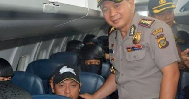 Australia complains after Indonesian police take pictures with men scheduled to die by firing squad