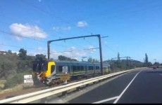 Two teenagers caught on camera clinging to the back of a speeding train