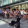 Busker drowns out homophobic preacher with rendition of Girls Just Wanna Have Fun