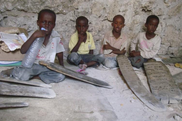 Somali boys read the Koran at a refugee camp in Mogadishu