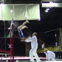 Safe hands: This coach saved his gymnast from a terrifying head-first fall TWICE!