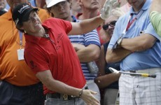 McIlroy battles on after injuring wrist at PGA
