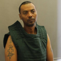 US police hunt armed prisoner who escaped wearing a hospital gown