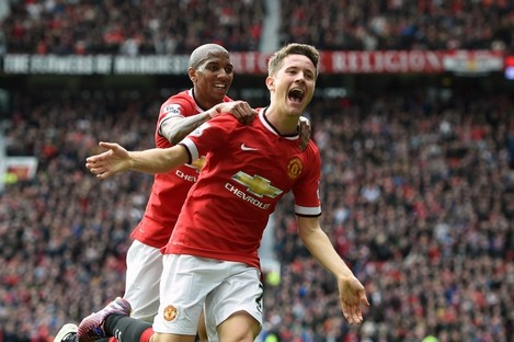 Young and Herrera celebrate United's opening goal.