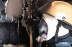 Two people rescued after fire engulfs kitchen