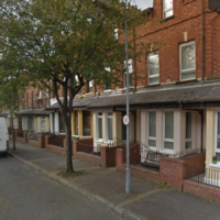 Group of men armed with pickaxe smash windows and threaten residents