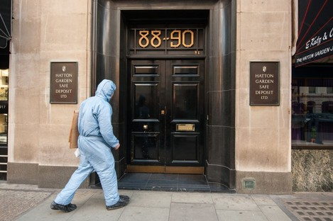 A police forensics officer enters the Hatton Garden Safe Deposit company.
