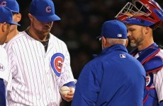 The Chicago Cubs' $155 million ace has the yips and can't throw the ball to first base
