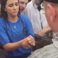 A girl avoided getting arrested by beating a police officer at rock, paper, scissors
