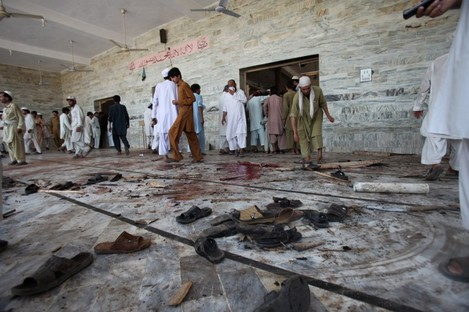 The floor of the mosque was scattered with blood and shoes after the blast.