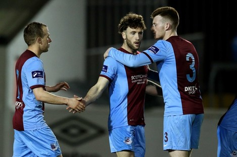 Lee Duffy celebrates his equaliser with Cathal Brady and Joe Gorman.