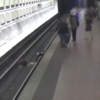 Man in wheelchair rescued after falling onto subway tracks