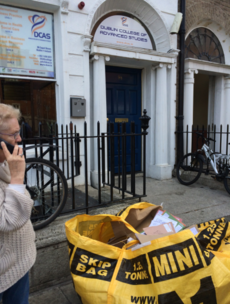 Photocopies of college students' passports left in a skip on busy street