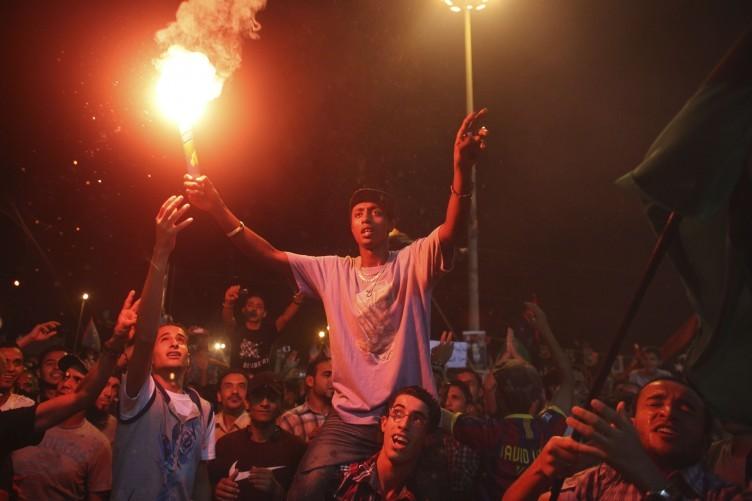 People in Benghazi celebrate news of uprisings in Tripoli against Muammar Gaddafi's regime.