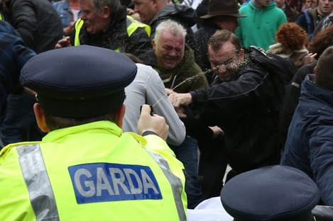 Garda using pepper spray on anti-austerity protesters outside the Dáil in 2013.