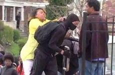 A Baltimore mother dragging her son out of riots has taken over the internet
