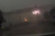 Violent storm blows train off elevated bridge