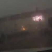 Violent storm blows train off elevated bridge