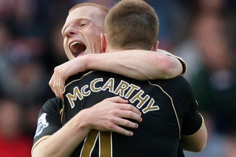 McCarthy celebrates a goal with Wigan team-mate Ben Watson.