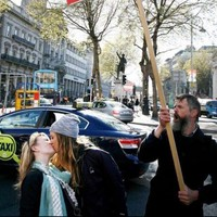 A photographer captured two girls defiantly kissing in front of a No protester in Dublin