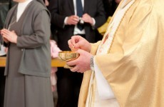 Poll: Should parents be allowed take photos during Communion ceremonies?