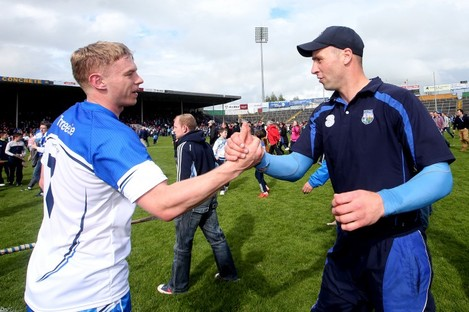 Philip Mahony celebrates Waterford's league title win with selector Dan Shanahan.