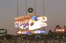 A gay couple embraced on a stadium kiss cam and the crowd loved it