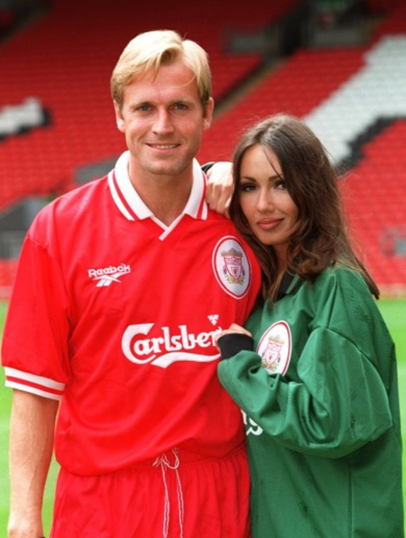 7a8638865a0 John Scales poses with Page 3 girl Kathy Lloyd to model Liverpool s new  Reebok kit in 1996.