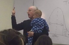 Here's why this photo of a professor holding his student's baby is going viral