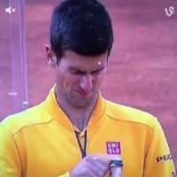 Djokovic nearly takes his eye out by showing how NOT to open a bottle of champagne