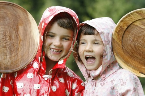 Sisters Aoife (6) and Tara Clark (5) from Harold's Cross have a laugh while attending various Heritage Week events in Merrion Square, Dublin today.