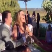 A boyfriend desperately tried to keep a bridal bouquet away from his girlfriend