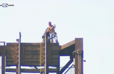 Police had to rescue a naked man who got himself stuck on a raised bridge