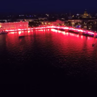 Zenit fans line city's river with flares to celebrate club's 90th birthday