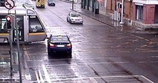 Worrying red light photos show impatient driver in near-miss with tram