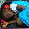 A boy found in a suitcase in Spain is being reunited with his mother