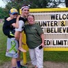 This teen is walking 57 miles with his brother strapped to his back