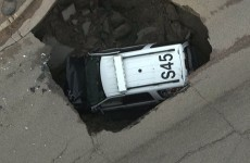 A giant sinkhole ate this police car...