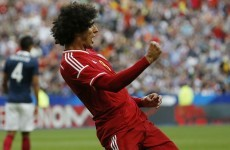 Marouane Fellaini scored twice as Belgium beat France in a 7-goal thriller