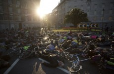 Cyclists hold vigil for woman killed by lorry by lying on the road with their bikes