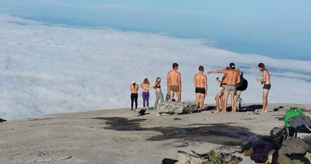 Tourists who stripped naked on a Malaysian mountain blamed for earthquake and now facing jail