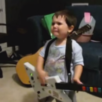 This kid heard Rage Against The Machine for the first time and lost the head