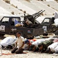 """Gaddafi: """"I won't surrender"""""""