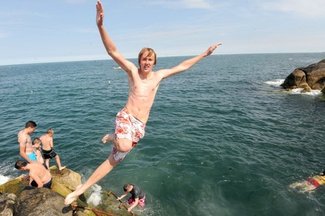 Luke Halligan (17 from Dublin) jumps in at the Forty Foot at Sandyove in 2012.