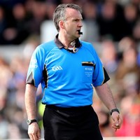 Referee Diarmuid Kirwan paid for getting a little too close to action this afternoon