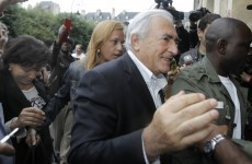 Strauss-Kahn returns to frosty reception and uncertain future